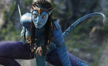 Female film fan shot in cinema halfway through watching Avatar