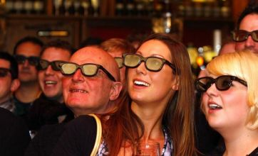 Football fans watch first live TV sports game in 3D