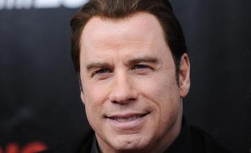 Travolta: Helping Haiti eased grief