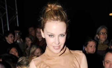 Kylie Minogue dresses up in sexy leather shorts