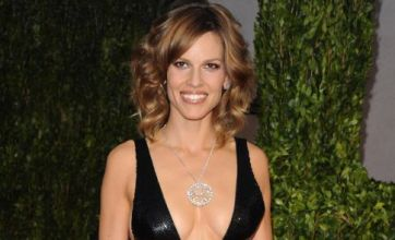 Hilary Swank reveals breasts at Oscars 2010: Dare to wear?