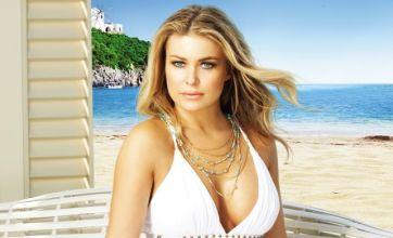 Carmen Electra regrets breast implants