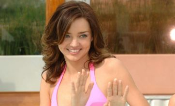 Miranda Kerr shows off her curves in revealing pink Victoria's Secret bikini