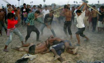 Frenzied Cambodian mob kills motorcycle thieves with bamboo sticks