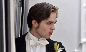 Robert Pattinson looks like the perfect gentleman as he films Bel Ami