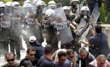 Three dead as Greek protesters clash with police