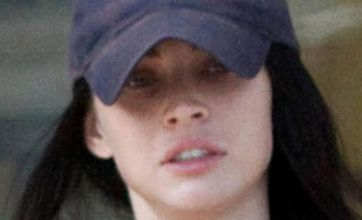 Megan Fox looks tired and stressed as she indulges in retail therapy again