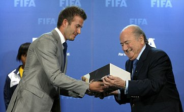 David Beckham hands over World Cup 2018 bid book to Fifa's Sepp Blatter