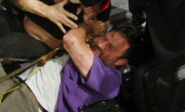 David Arquette knocked to the ground as he breaks up a fight
