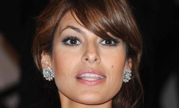 Eva Mendes strips with purpose