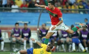 Cristiano Ronaldo tussles with Brazil's Daniel Alves