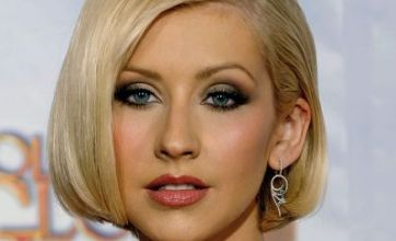 Christina Aguilera admits her leather and latex gear is not just for the stage