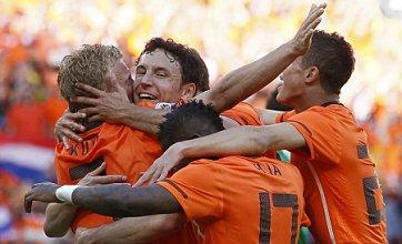 Holland claim simple win over Denmark in opener