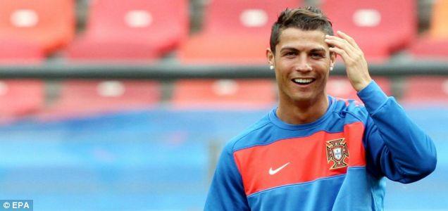 All smiles: Portugal's Cristiano Ronaldo during training