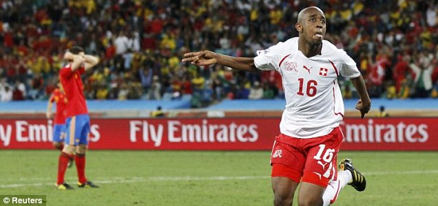 Switzerland's Gelson Fernandes celebrates scoring against Spain