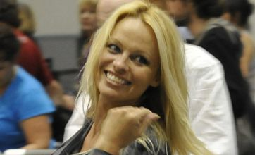 Shoeless Pamela Anderson shows off her toned legs at airport