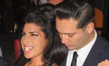 Amy Winehouse takes boyfriend Reg Traviss to meet the family