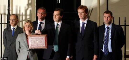 Chancellor George Osborne, flanked by Lib Dem Danny Alexander and the rest of his Treasury team prior to delivering the budget