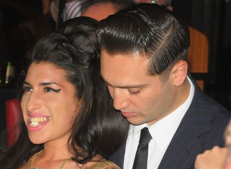 Amy Winehouse and Reg Traviss look completely in love