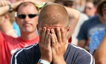 Glastonbury Festival 2010: Fans boo as England crashes out of World Cup