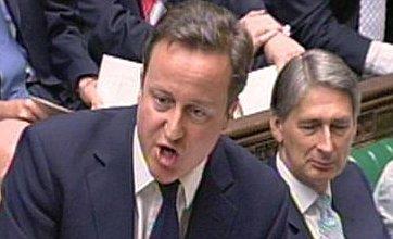David Cameron backs Kenneth Clarke in row over prisoners