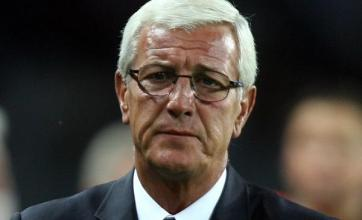 Lippi holds his hands up