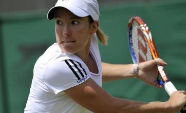 Henin sets up Clijsters clash