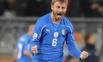 De Rossi spares Italy's blushes