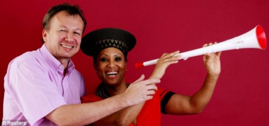 Austrian goldsmith Klemens Pointner and his friend Sandra Andrews from South Africa with the gold and jewel covered vuvuzela