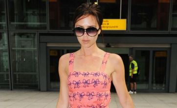 Victoria Beckham looks pretty in pink as she jets in from France