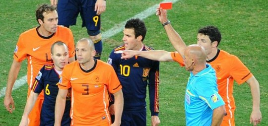 Howard Webb issues a red card to Netherlands defender John Heitinga