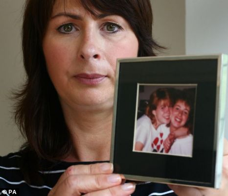 Nicola Stalk holds pictures of her missing sister Louise Kaye as she appeals to serial killer Peter Tobin