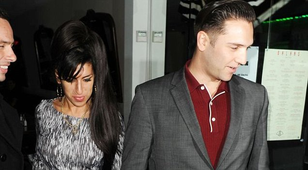 Reg Traviss' ex has claimed she was sleeping with the director up until a week ago