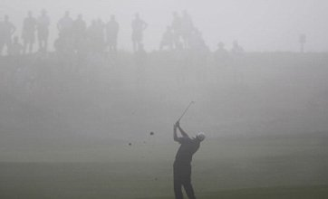 Tiger Woods lifts gloom at foggy PGA Championship with bright start