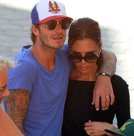 David and Victoria Beckham snuggle (Xposure)