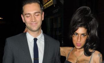 Amy Winehouse stands by her man Reg Traviss