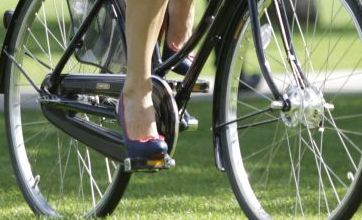 Kelly Brook promotes cycling with Boris Johnson but forgets her trainers