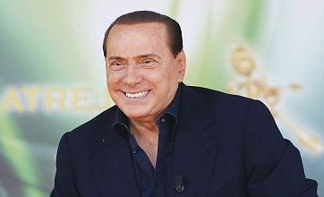 Silvio Berlusconi gaffes again and laughs off gag about Hitler