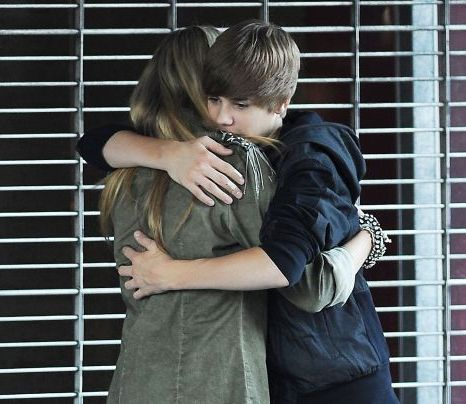 Justin Bieber hugs his teen co-star as they shoot the music video for U Smile (Photo: Xposure)