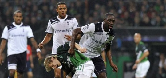In the thick of it: Spurs' Ledley King in action against Werder Bremen's Marko Marin