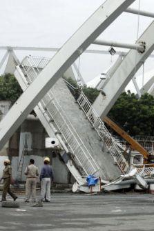 The collapsed pedestrian bridge outside the Jawaharlal Nehru Stadium in New Delhi