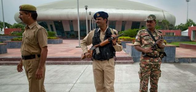 Secure: Indian police stand guard outside the weightlifting venue after pieces of a false roof inside collapsed ahead of the Commonwealth Games