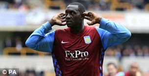 Pardon? Aston Villa's Emile Heskey responds to the Wolves fans' abuse with a late winner