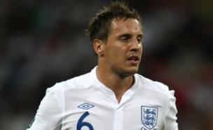 Phil Jagielka will miss England's game against Montenegro (PA)