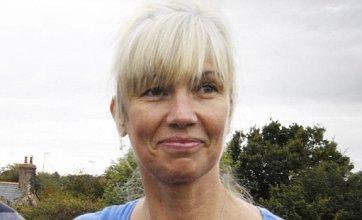 Probe as landlady is found dead on beach