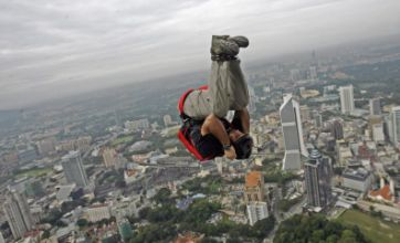Pictures: 120 Base jumpers brave 1,380ft Kuala Lumpur Tower