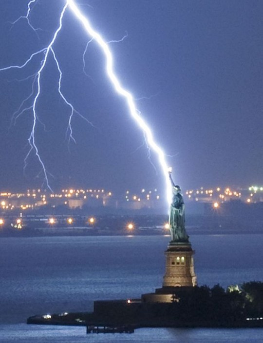 The lady in charge: The moment the Statue of Liberty was hit by lightning (Pic: Caters)