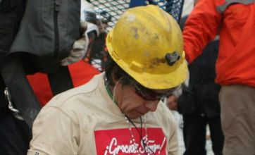 Oldest miner drops to his knees as rescue continues