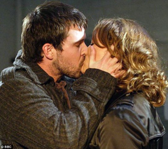 Wedded bliss: Janine and Ryan passionately kisssing...but are there more sinister thoughts in her mind?