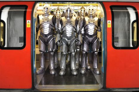 A group of Cybermen on the London Underground